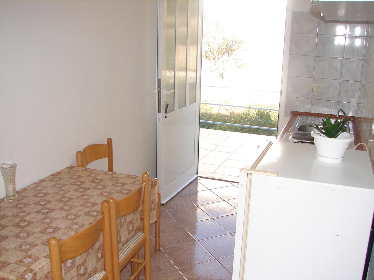 00217VIGA - Viganj - Appartamenti Croazia - A3(4): la cucina con la sala da pranzo