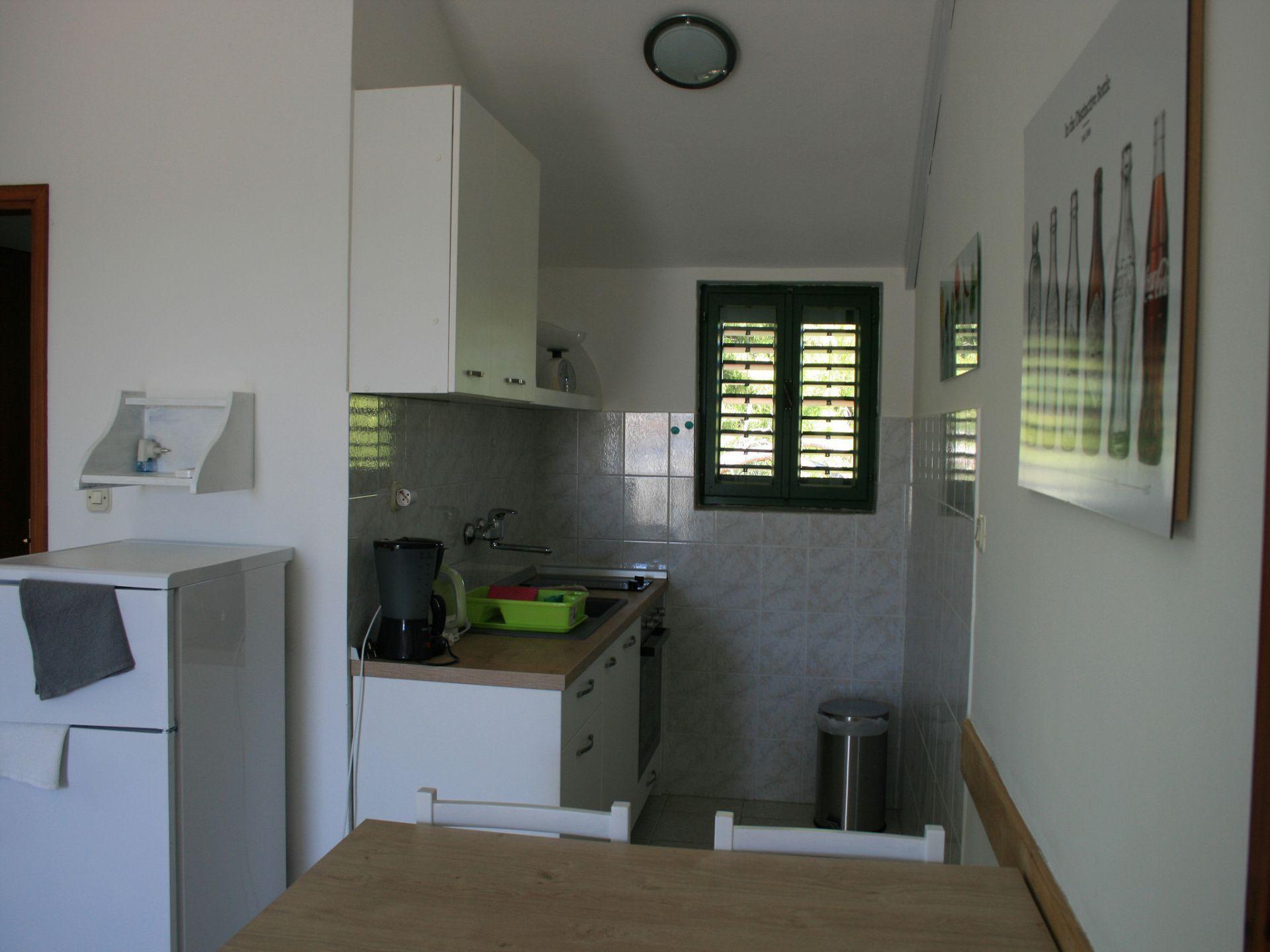 37656 - Jezera - Apartments Croatia - A-Marta(2+2): kitchen and dining room