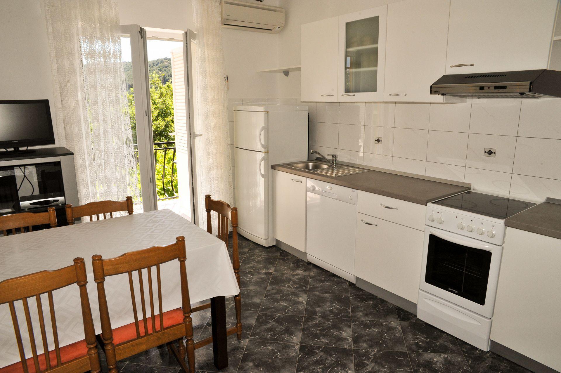 BP - Lopar - Appartementen Kroatië - A1 (5): keuken en eetkamer