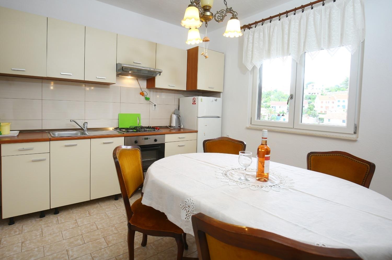 Neda - Splitska - Appartementen Kroatië - A1(6): keuken en eetkamer